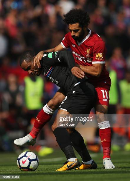 Jason Puncheon of Crystal Palace and Mohamed Salah of Liverpool battle for possession during the Premier League match between Liverpool and Crystal...