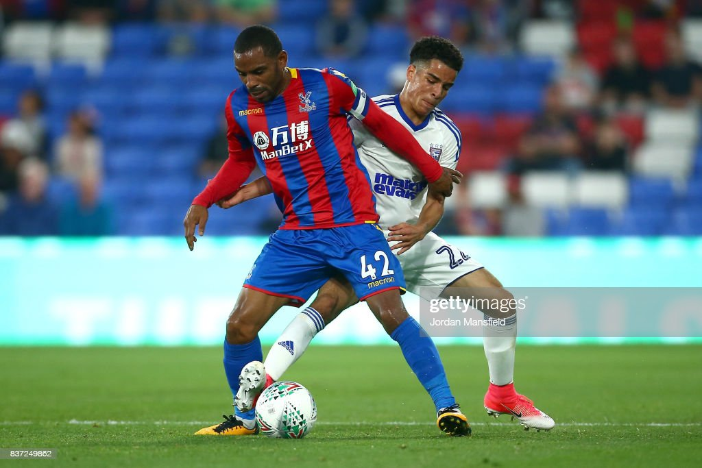 Jason Puncheon of Crystal Palace and Tristan Nydam of Ipswich battle for possession during the Carabao Cup Second Round match between Crystal Palace and Ipswich Town at Selhurst Park on August 22, 2017 in London, England.