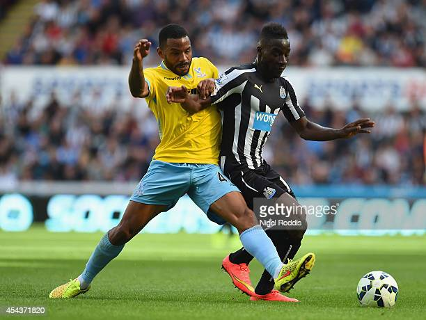 Jason Puncheon of Crystal Palace battles with Massadio Haidara of Newcastle United during the Barclays Premier League match between Newcastle United...