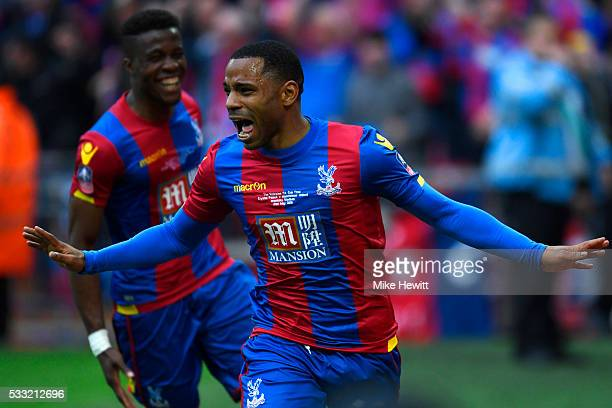 Jason Puncheon of Crystal Palace celebrates with Wilfried Zaha as he scores their first goal during The Emirates FA Cup Final match between...