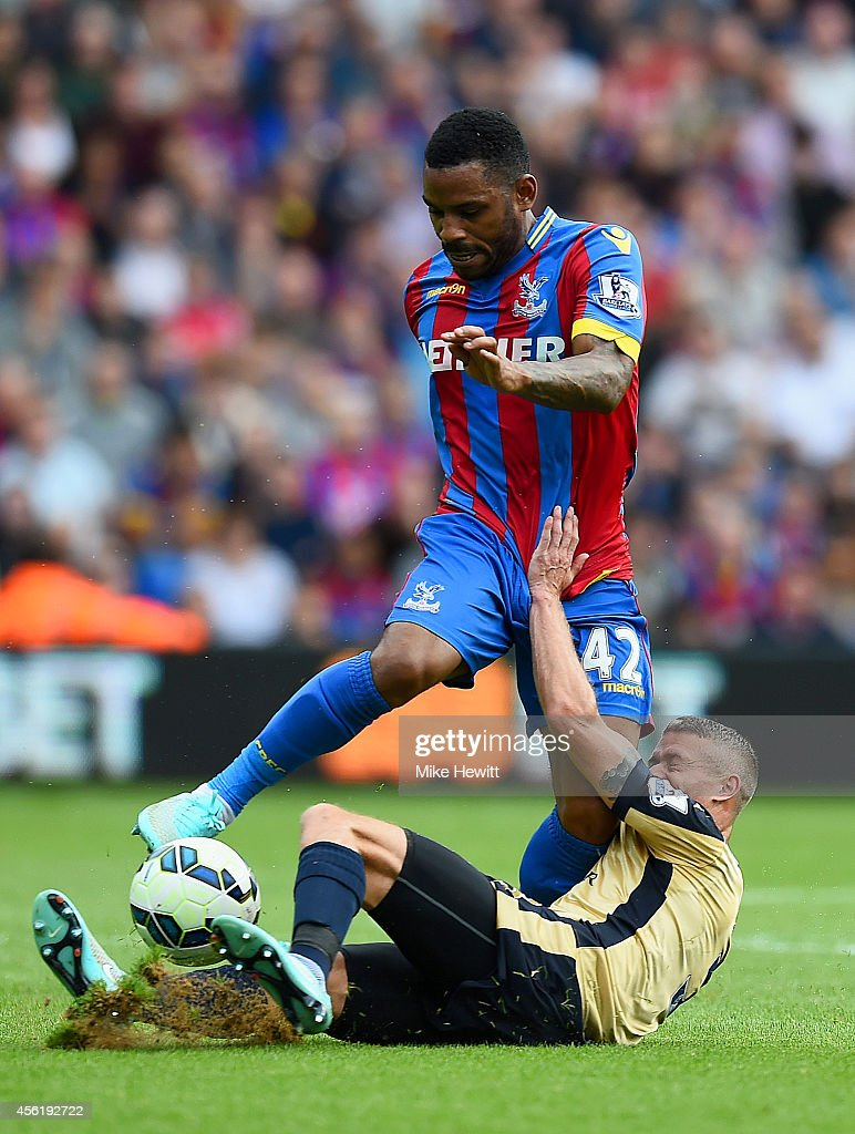 Jason Puncheon of Crystal Palace in action against Paul Konchesky of Leicester City during the Barclays Premier League match between Crystal Palace and Leicester City at Selhurst Park on September 27, 2014 in London, England.