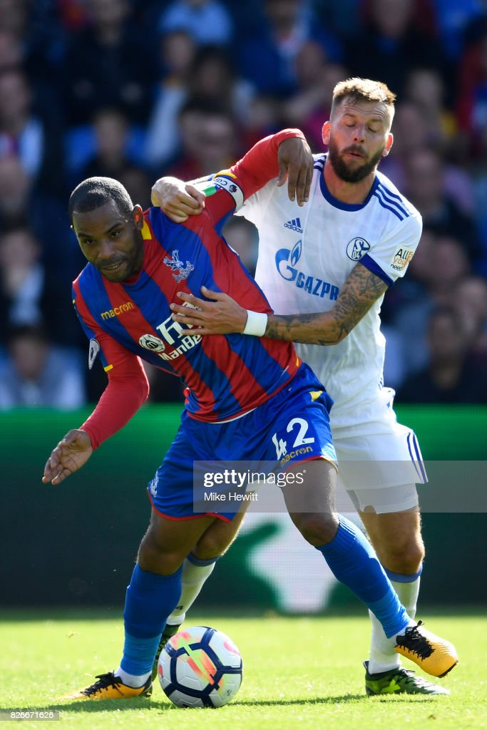 Jason Puncheon of Crystal Palace is challenged by Guido Burgstaller of Schalke during a Pre Season Friendly between Crystal Palace and FC Schalke 04 at Selhurst Park on August 5, 2017 in London, England.