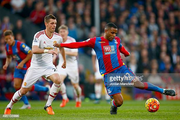Jason Puncheon of Crystal Palace is challenged by Morgan Schneiderlin of Manchester United during the Barclays Premier League match between Crystal...