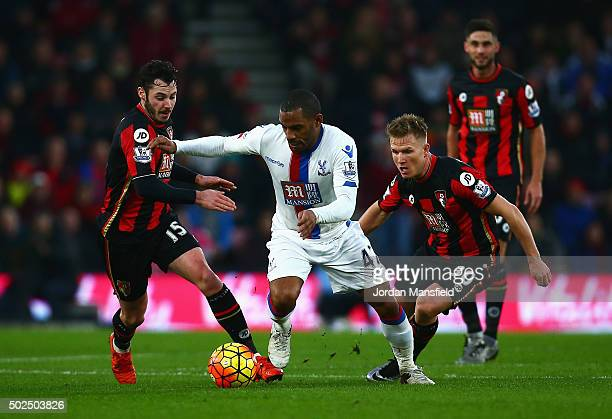 Jason Puncheon of Crystal Palace is closed down by Adam Smith and Matt Ritchie of Bournemouth during the Barclays Premier League match between AFC...