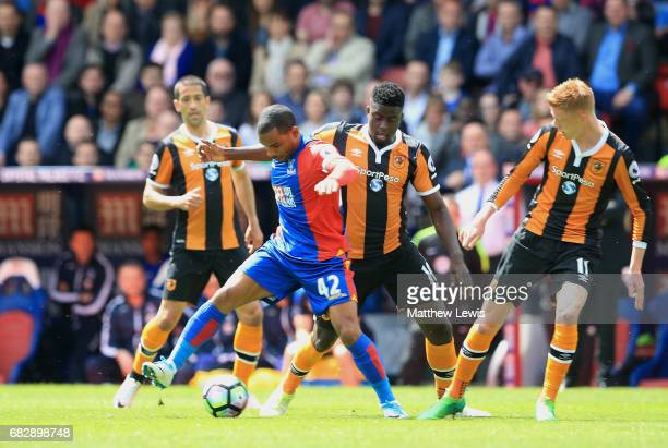 Jason Puncheon of Crystal Palace is put under pressure from Alfred N'Diaye of Hull City during the Premier League match between Crystal Palace and...