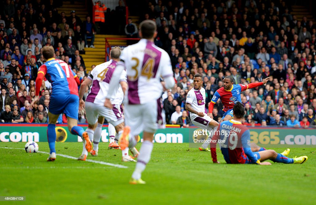 Jason Puncheon of Crystal Palace (2R) scores their first goal during the Barclays Premier League match between Crystal Palace and Aston Villa at Selhurst Park on April 12, 2014 in London, England.