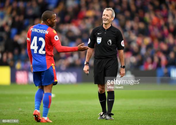 Jason Puncheon of Crystal Palace speaks with Referee Martin Atkkinson during the Premier League match between Crystal Palace and Watford at Selhurst...