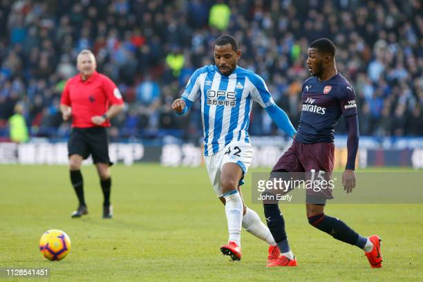 Jason Puncheon of Huddersfield Town bursts past Ainsley MaitlandNiles of Arsenal during the Premier League match between Huddersfield Town and...