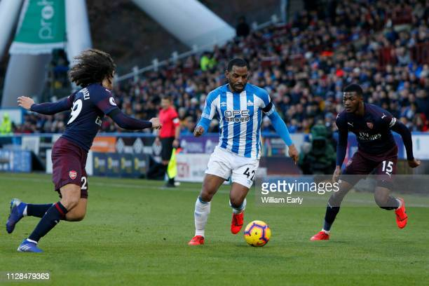 Jason Puncheon of Huddersfield Town Matteo Guendouzi and Ainsley MaitlandNiles of Arsenal during the Premier League match between Huddersfield Town...