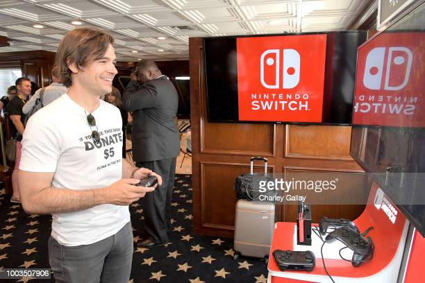 Jason Ralph tests his skills on Super Smash Bros Ultimate for Nintendo Switch at the Variety Studio at ComicCon 2018 on July 21 2018 in San Diego...