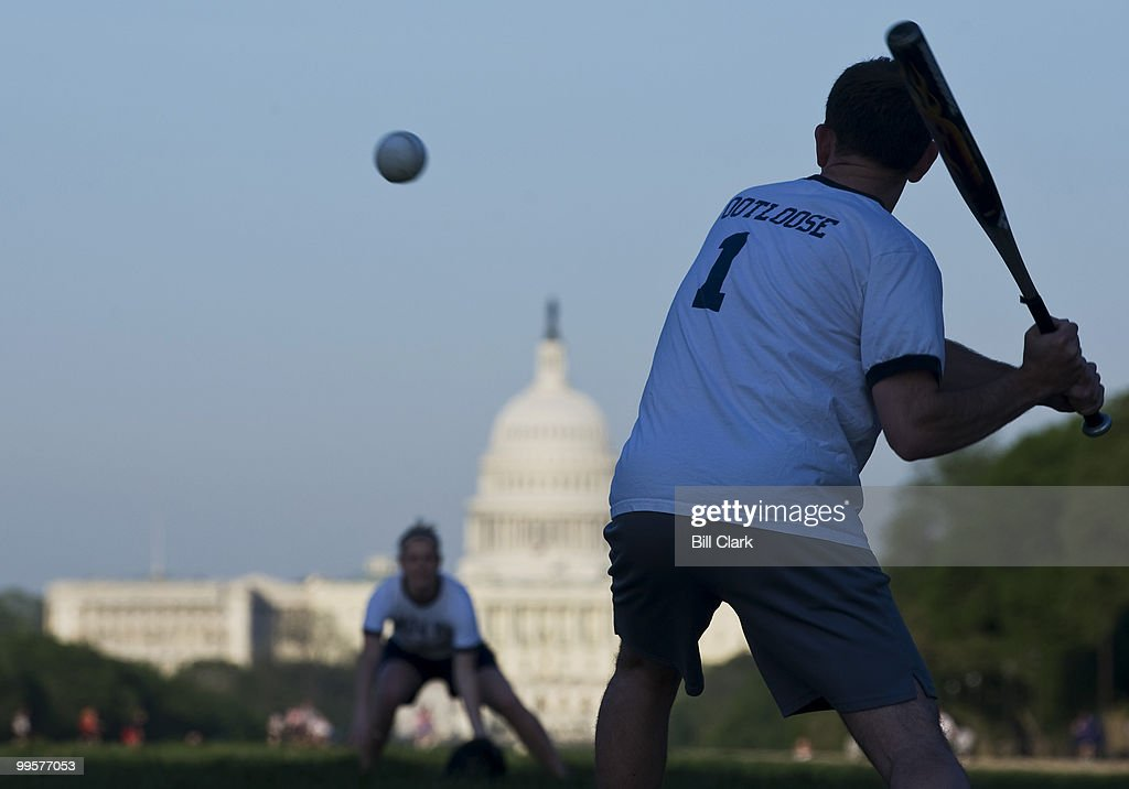 Jason Rauch, of Rep. Ike Skelton's office, takes his turn at bat during the Show Me Asses softball team practice on the National Mall on Monday, April 27, 2009.