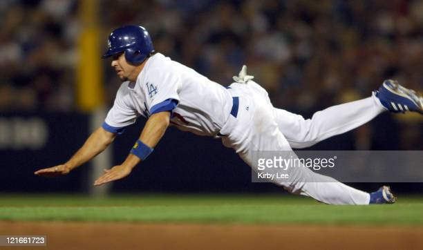 Jason Repko of the Los Angeles dives toward second base in the fifth inning of 84 loss to the Detroit Tigers at Dodger Stadium in Los Angeles Calif...