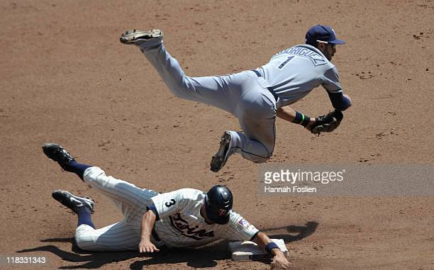 Jason Repko of the Minnesota Twins is out at second as Sean Rodriguez of the Tampa Bay Rays turns a double play to end the fourth inning on July 6...