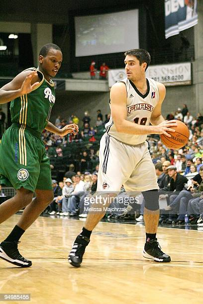 Jason Richards of the Utah Flash drives the ball against Russell Robinson of the Reno Bighorns during the D-League game on December 11, 2009 at the...
