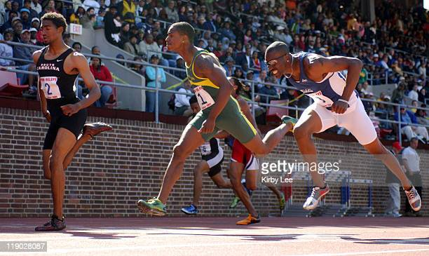 Jason Richardson of South Carolina holds off Eric Mitchum of Oregon and Linnie Yarbrough of Middle Tennessee State to win the college 110meter high...