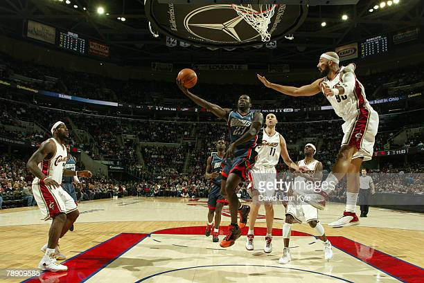 Jason Richardson of the Charlotte Bobcats goes up for the layup against Drew Gooden of the Cleveland Cavaliers at the Quicken Loans Arena January 11...