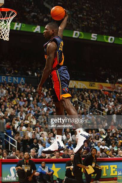 Jason Richardson of the Golden State Warriors makes a dunk to go on to win the Sprite Rising Stars Slam Dunk Contest during the 2003 NBA AllStar...