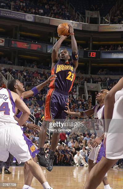 Jason Richardson of the Golden State Warriors shoots against the Phoenix Suns at America West Arena on November 28 2003 in Phoenix Arizona NOTE TO...