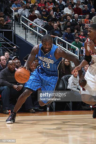 Jason Richardson of the Orlando Magic drives against Joe Johnson of the Atlanta Hawks on December 20 2010 at Philips Arena in Atlanta Georgia NOTE TO...