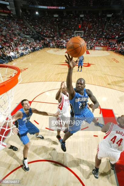 Jason Richardson of the Orlando Magic shoots the ball over Kyle Lowry and Chuck Hayes of the Houston Rockets on January 22 2011 at the Toyota Center...