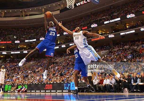 Jason Richardson of the Philadelphia 76ers grabs a rebound away from Kenneth Faried of the Denver Nuggets at the Wells Fargo Center on October 31...