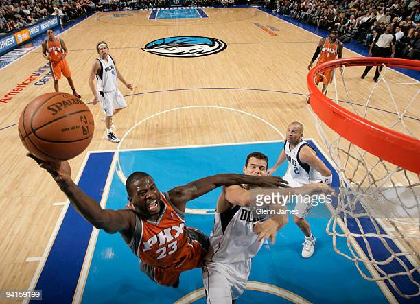Jason Richardson of the Phoenix Suns goes up for the layup against Kris Humphries of the Dallas Mavericks during a game at the American Airlines...