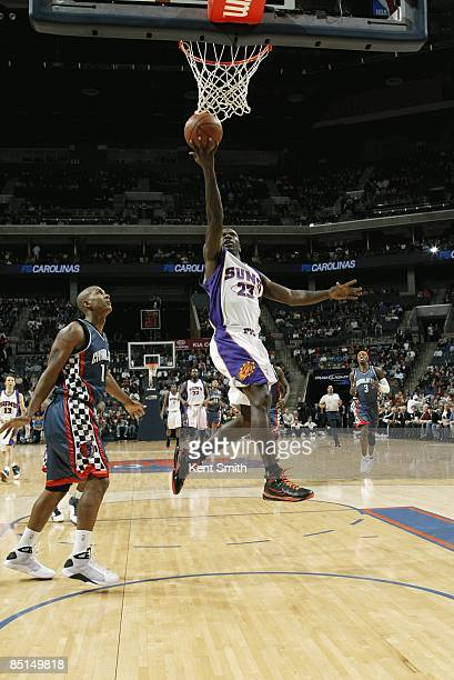 Jason Richardson of the Phoenix Suns takes the ball to the basket past Raja Bell of the Charlotte Bobcats during the game on January 23 2009 at the...