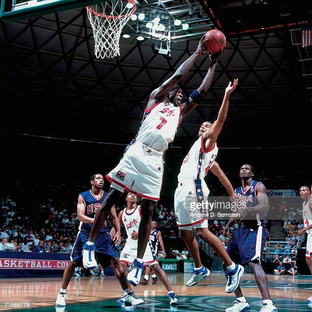 Jason Richardson of the United States Select Team grabs a rebound against the United States National Team during a pre-Olympic exhibition game at...