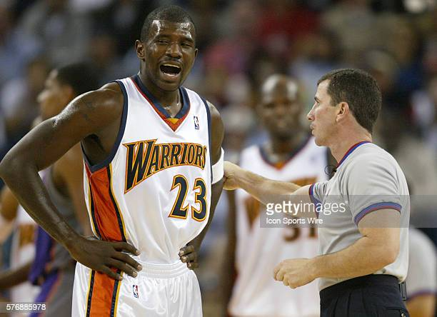 Jason Richardson of the Warriors argues with the referee Tim Donaghy about his foul during the second half of the game against the Suns at Oakland...