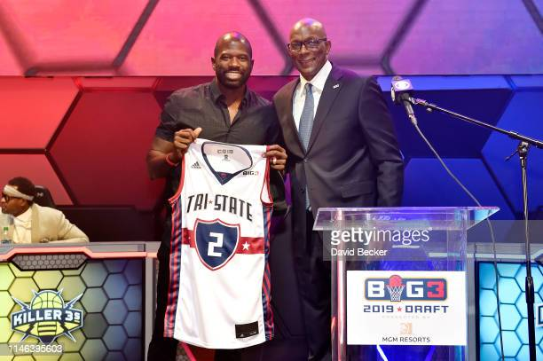 Jason Richardson poses with BIG3 Commissioner Clyde Drexler after being drafted at by the TriState in the second round during the BIG3 Draft at the...