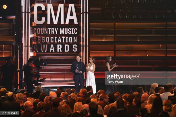 Jason Ritter and JoAnna Garcia Swisher speak onstage during the 51st annual CMA Awards at the Bridgestone Arena on November 8 2017 in Nashville...