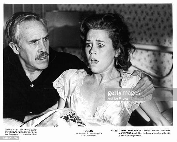 Jason Robards comforts Jane Fonda as she wakes from a nightmare in a scene from the film 'Julia' 1977