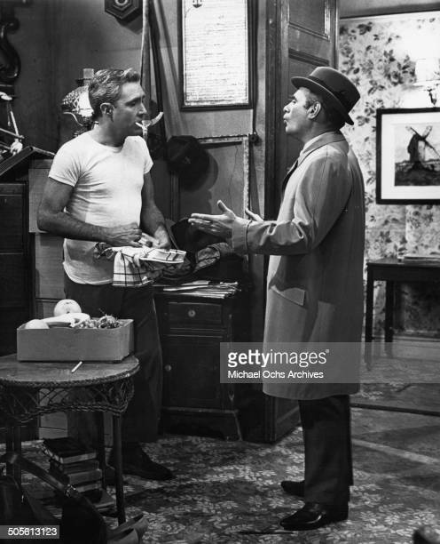 Jason Robards listens to Martin Balsam in a scene from the movie A Thousand Clowns circa 1965
