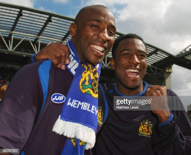 Jason Roberts and Nathan Ellington of Wigan Athletic celebrate promotion following the CocaCola Championship match between Wigan Athletic and Reading...