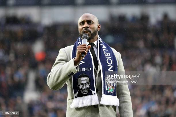 Jason Roberts former West Bromwich Albion player and nephew of Cyrille Regis talks prior to the Premier League match between West Bromwich Albion and...