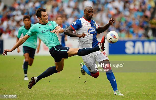 Jason Roberts of Blackburn Rovers and Fernando Recio Comi of Kitchee compete for the ball during the Asia Trophy preseason friendly match at the Hong...
