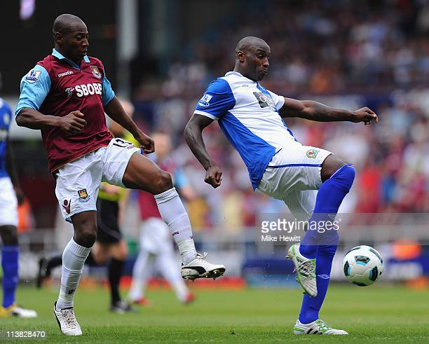 Jason Roberts of Blackburn Rovers attempts to clear the ball as he is closed down by Luis Boa Morte of West Ham United during the Barclays Premier...