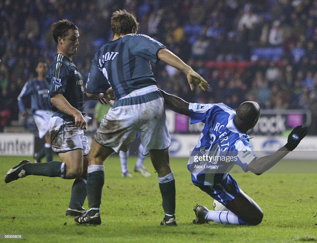 Jason Roberts (R) of Wigan Athletic is brought down by Robbie Elliott of Newcastle United for a penalty during the Carling Cup fourth round match between Wigan Athletic and Newcastle United at the JJB Stadium on November 30, 2005 in Wigan, England