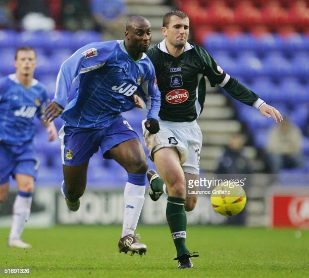 Jason Roberts of Wigan battles with Paul Wotton of Plymouth scores the opening goal during the CocaCola Championship match between and Wigan Athletic...