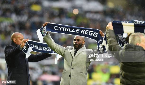 Jason Roberts pays tribute to Cyrille Regis before the Premier League match between West Bromwich Albion and Southampton at The Hawthorns on February...