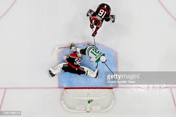 Jason Robertson of the Dallas Stars scores a goal past Nikita Zadorov and Kevin Lankinen of the Chicago Blackhawks in the second period at the United...