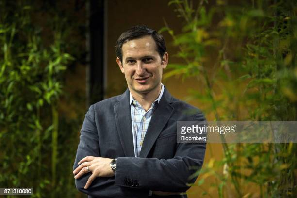 Jason Robins cofounder and chief executive officer of DraftKings Inc poses for a photograph following a Bloomberg Television interview at the Lisbon...