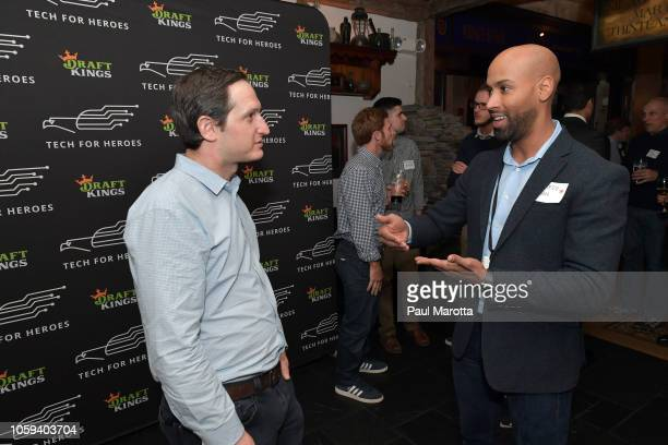 Jason Robins speaks with a veteran at DraftKings Hosts Veterans Appreciation Event at MJ O'Connors on November 8 2018 in Boston Massachusett