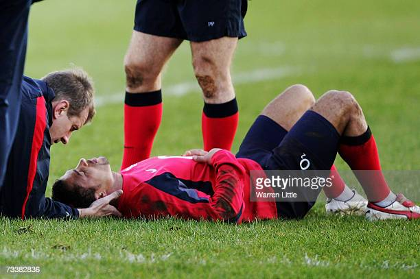 Jason Robinson of England receives treatment after making a tackle during an England rugby training session at Bath University on February 21 2007 in...