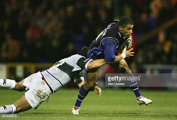 Jason Robinson of Sale Sharks is tackled by Nils Mordt of London Irish during the Zurich Premiership match between Sale Sharks and London Irish at...