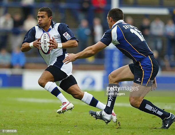 Jason Robinson of Sale takes on Andre Snyman during the Zurich Premiership match between Leeds Tykes and Sale Sharks at Headingley on October 3 2004...