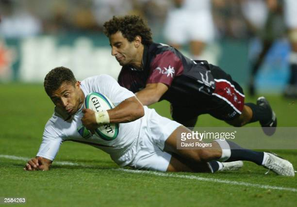 Jason Robinson, the England wing dives over to score a try during the Rugby World Cup Pool C match between England and Georgia at Subiaco Oval...