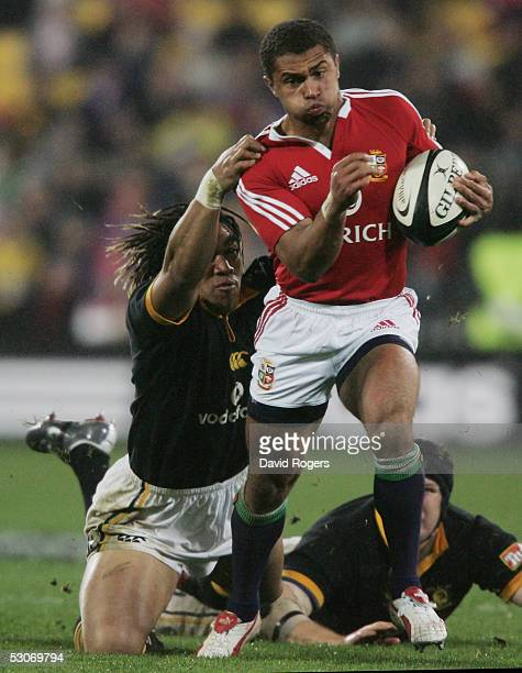 Jason Robinson the Lions wing is tackled by Ma'a Nonu during the match between the British and Irish Lions and Wellington at The Westpac Stadium on...