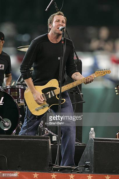 Jason Ross lead vocalist and guitar player for Seven Mary Three performs before the Major League Baseball Legends and Celebrity Softball Game at...