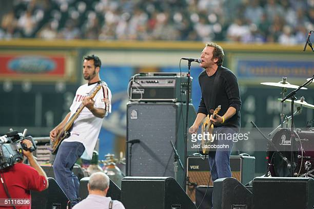 Jason Ross lead vocalist and guitar player for Seven Mary Three performs with Casey Daniel on bass before the Major League Baseball Legends and...
